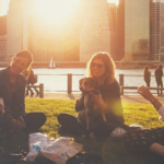 Millennial youth picnicking in an urban park, avoiding FOMO (fear of missing out).
